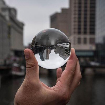 City reflected in glass ball